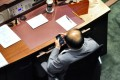 Eddie Ng is seen checking his smartphone. Photo: SCMP