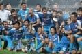 Kitchee players celebrate after defeating Sun Pegasus 1-0 in yesterday's FA Cup final at Hong Kong Stadium. Photo: Nora Tam