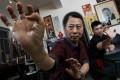 Hung Kuen master Lam Chun-fai, 73, and his son Oscar Lam Chuen-ho, 28, demonstrate their craft. Photo: Felix Wong