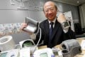The Consumer Council's publicity and community relations committee chairman Michael Hui King-man shows a range of electronic blood pressure monitors. Photo: May Tse