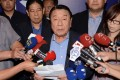 Philippine special envoy Amadeo Perez (centre) reads a statement of apology at Taoyuan International Airport. Photo: AFP