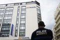 A policeman stands guard outside the Novotel Hotel in central Cannes after Chopard jewellery worth more than US1m was stolen at the hotel. Photo: AFP
