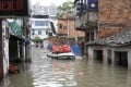 Rescuers paddle a boat to transport residents on a flooded street after a heavy rainstorm hit Nanchang, Jiangxi province this week. Photo: Reuters