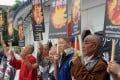 Tibetans display portraits of people who killed themselves in self-immolation, during a protest in front of the Liberty Square in Taipei. Photo: AFP