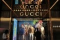 A man watches in front of a window display outside a Gucci store in Hong Kong January 17, 2013. Photo: Reuters