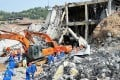 Rescuers work at the accident site after a blast ripped through an explosives manufacturing plant owned by Poly Explosives (Jinan) in east China's Shandong province, on Tuesday. Photo: Xinhua