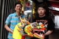 Ha Chung-kin and son San at the Sai Ying Pun shop where they are making a very special Tuen Ng festival dragon boat. Photo: Jonathan Wong