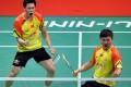 Liu Xiaolong and Qiu Zihan of China celebrate their men's doubles victory. Photo: Xinhua