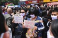 Protesters wear face masks at a demonstration in Kunming on May 16. Photo: Screenshot from Sina Weibo