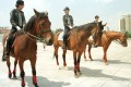 Policewomen patrol on horseback at a park in Dalian, Liaoning province in northeast China. Photo: AP