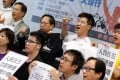 Civil Human Rights Front members show their enthusiasm at yesterday's media briefing on the July 1 march. Photo: Sam Tsang