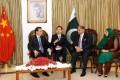 Chinese Premier Li Keqiang (left) talking with Pakistan's Senate Chairman Nayyar Bukhari, as former speaker of Pakistan's National Assembly Fehmida Mirza looks on. Photo: EPA