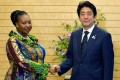 South African singer and Unicef goodwill ambassador Yvonne Chaka Chaka shakes hands with Japanese Premier Shinzo Abe. Photo: AFP