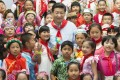 President Xi Jinping poses for group photo with children, May 29, 2013. Photo: Xinhua
