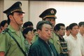 Former Beijing mayor Chen Xitong stands in Beijing's Municipal Higher People's Court in 1998 when he was sentenced to 16 years in jail for his part in a graft scandal. Photo: AP