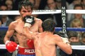 Manny Pacquiao takes a punch from Juan Manuel Marquez.