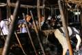 Investigators work inside the debris of the burned bus in Xiamen. Photo: Xinhua