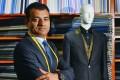 Arshad Mahmood shows off Apsley Tailors' suit. Photo: Thomas Yau