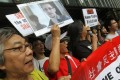Members of League of Social Democrats gather at HSBC headquarters and march to the US consulate to support Edward Snowden. Photo: SCMP/Edward Wong