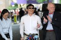 Chen Guangcheng, with NYU professor Jemore Cohen (right), arrives at NYU in May 2012. Photo: AFP