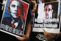 Supporters hold pictures of US President Barack Obama and Edward Snowden at a Hong Kong protest. Photo: AP