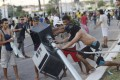 Demonstrators tear down a traffic light during clashes with riot police near the Estadio Castelao in Fortaleza. Photo: Reuters
