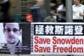 A banner supporting Edward Snowden, a former contractor at the National Security Agency, is seen at Central district. Photo: David Wong