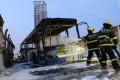 Firefighters try to extinguish the fire on a bus in Xiamen, southeast China's Fujian Province. Photo: Xinhua