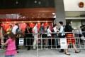 Long queues form outside the China Visa Application offices in Hong Kong. Photo: Jonathan Wong