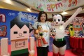 SHKP's Maureen Fung with Astro Boy at an APM Mall promotion.