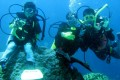 Tony Lit (right) bonds with his sons on one of many diving expeditions.