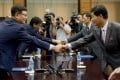 Head of the South Korean delegation Suh Ho (left) shakes hands with his North Korean counterpart Park Chol-su. Photo: Reuters