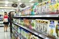 Infant formula sold in a Beijing supermarket. Hong Kong has not set limits for the trans-fat content of baby formula but is considering it. Photo: AFP