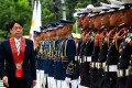 Japanese Defence Minister Itsunori Onodera reviews the honour guard in the Philippines in June. Photo: Xinhua