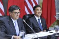 Funny? US Treasury Secretary Jacob Lew (left) and Chinese Vice-Premier Wang Yang attend the opening session of economic talks in Washington. Photo: Xinhua