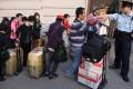 Mainland parallel traders queue outside Sheung Shui station. Photo: Sam Tsang