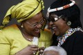 Graca Machel (left), Nelson Mandela and ex-wife Winnie Madikizela-Mandela share a laugh at his 90th birthday party in 2008.Photo: AFP