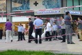 A dead body is carried away after a knife-wielding man killed two people near a shopping mall in Beijing. Photo: AFP