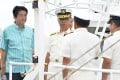 Japan's Prime Minister Shinzo Abe (left) smiles as he meets officers of Japan Coast Guard at his inspection tour on patrol ship Ishigaki in Ishigaki, southern Japan, on Wednesday. Photo: AP