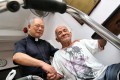 Pastor Lee Mo-fan was delighted to give street sleeper Wong Wah a helping hand. Photo: K.Y. Cheng