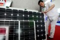 China's Ministry of Commerce said that it would impose provisional anti-dumping duties starting from 24 July 2013 on imported solar-grade polysilicon from the United States and Korea. Photo: EPA
