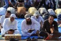 Egyptian supporters of deposed president Mohamed Morsi read the Koran, Islam's holy book, and pray, as they continue to hold a sit in outside Cairo's Rabaa al-Adawiya mosque. Egypt was braced for more bloodshed on Friday. Photo: AFP