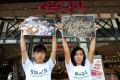 Friends of the Earth's Chan Kwun-fat (left) and Celia Fung Sze-lai outside an Aeon store in Tsuen Wan yesterday. Photo: Dickson Lee