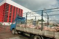 A truck carrying a load of pigs arrives at Sheung Shui slaughterhouse.