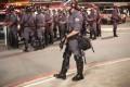 Police guard during a protest in support of Rio de Janeiro's protests and against Sao Paulo's governor Geraldo Alckmin in Sao Paulo, Brazil. Photo: Xinhua