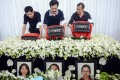 The fathers of pupils (from left) Liu Yipeng, Wang Linjia and Ye Mengyuan - victims of the Asiana plane crash in San Francisco - carry their daughters' urns at a service in Jiangshan yesterday. Photo: Xinhua