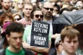 A protester in Sydney holds a poster during a rally in support of asylum seekers on July 20. Photo: Reuters