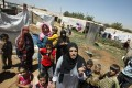 Syrian women and children talking to reporters in a refugee camp. The UN is worried about the plight of women and children in Homs. Photo: Reuters