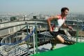 Clement Dumont strides to the finish line after climbing the 2,041 steps in Beijing's tallest building. Photo: Simon Song