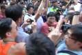A man in orange hits Lo Kwok-fai (in blue). Photo: SCMP